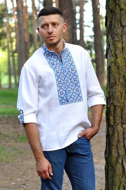 Современная рубашка-оберег из льна с выразительной вышивкой